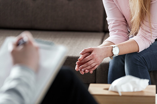 Close-up of woman's hands during counselling session